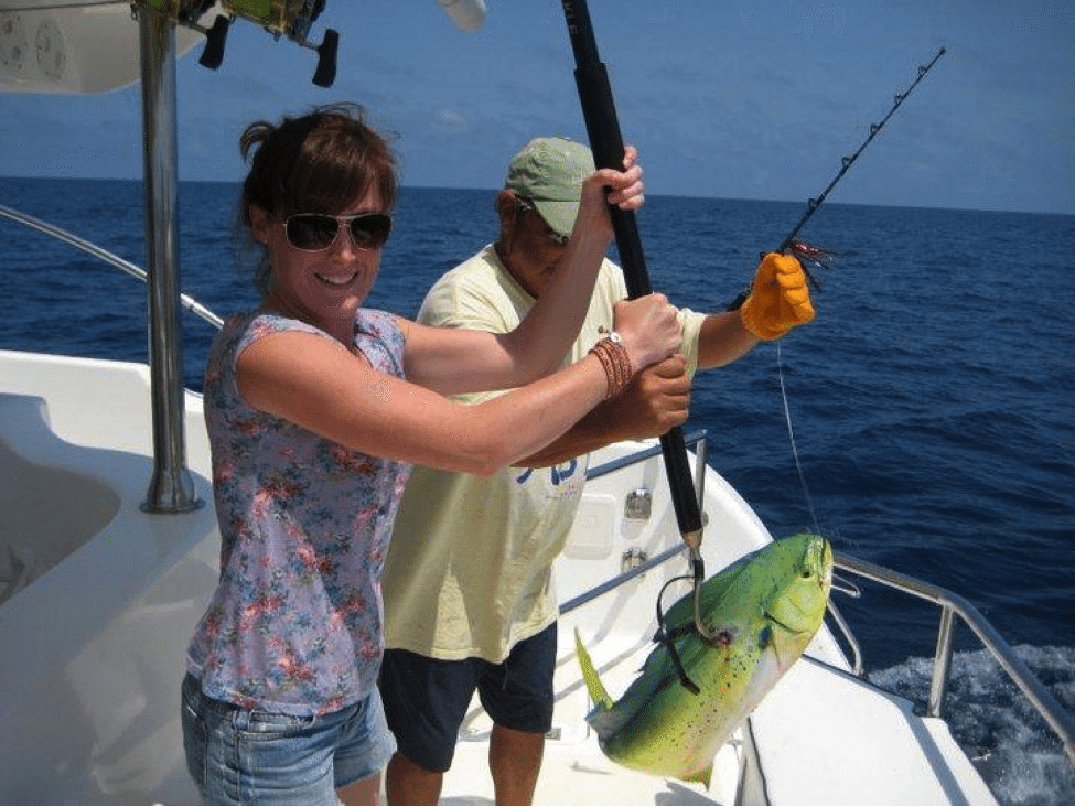Katy DeGrass on a boat deep sea fishing